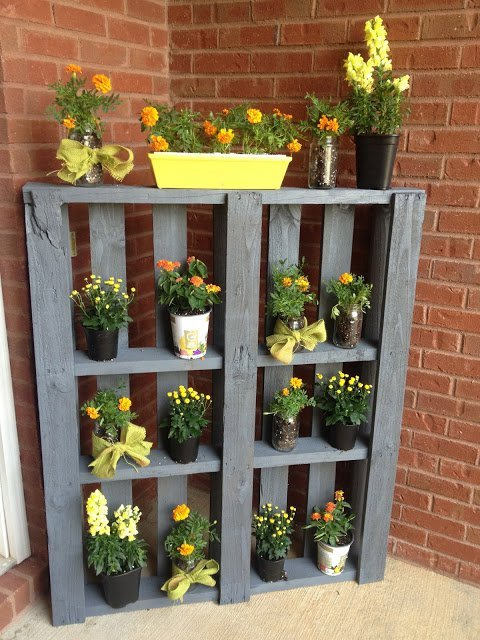 34 DIY Projects You Need To Make This Spring13 -DIY Pallet Plant Stand PVC pipes as bathroom storage