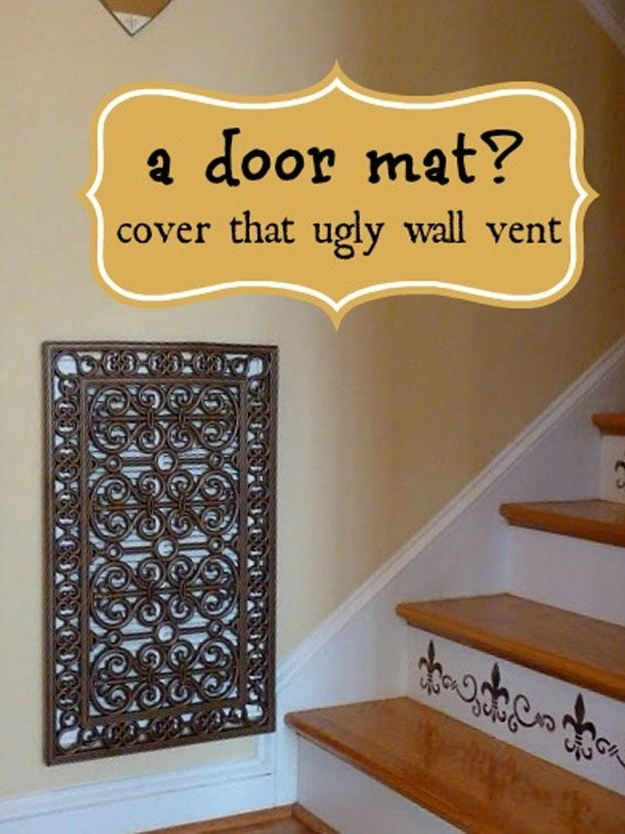 Genius Ways To Hide The Eyesores In Your Home - Repurposed door mat to cover and ugly wall vent