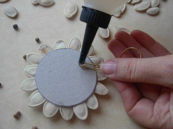 DIY-Pumpkin-Seed-Flower-Christmas-Ornament5.jpg