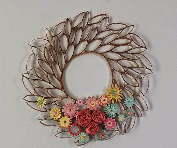 How to diy 3d paper roll flower wall art for Waste paper wall hanging