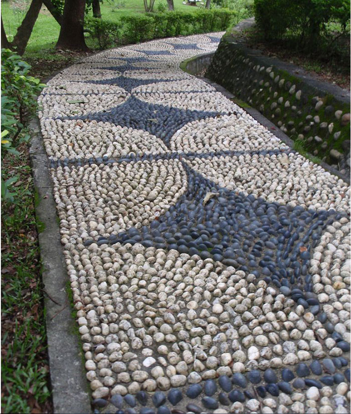 How to DIY Swirl Pebble Mosaic Garden Path wwwFabArtDIYcom