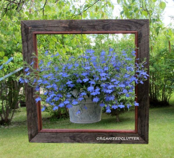 20 Fabulous Art DIY Garden Projects for This Spring - hanging pot flowers in a frame