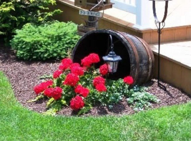 20 Fabulous Art DIY Garden Projects for This Spring - modified DIY wine barrel planter overflowing