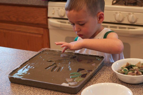 Hand & Footprint Art DIY Ideas and Projects - diy your own handprint garden stepping stone tutorial