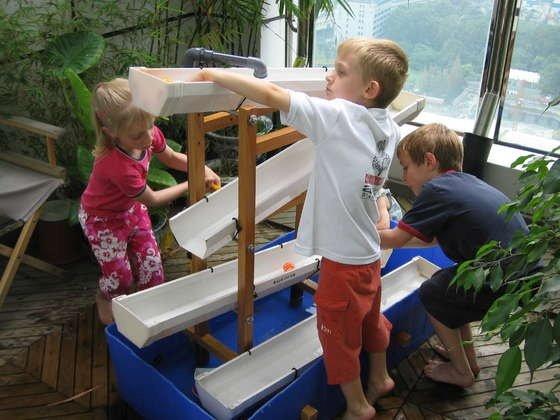 15 Fabulous DIY Rain Gutter Projects For Home and Garden - DIY River rock rain gutter River rock rain gutter garden edging