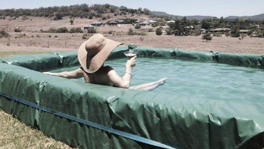 How to build a hay bale swimming pool - How to make a cheap swimming pool ...