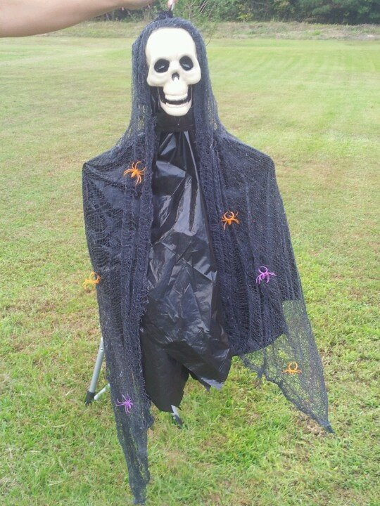 12 DIY Scary Trash Bag Halloween Decorations-Hanging skeleton