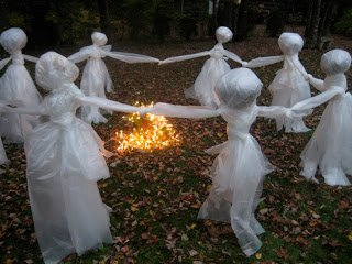 12 DIY Scary Trash Bag Halloween Decorations-Trash Bag Figures Dancing Around a Fire