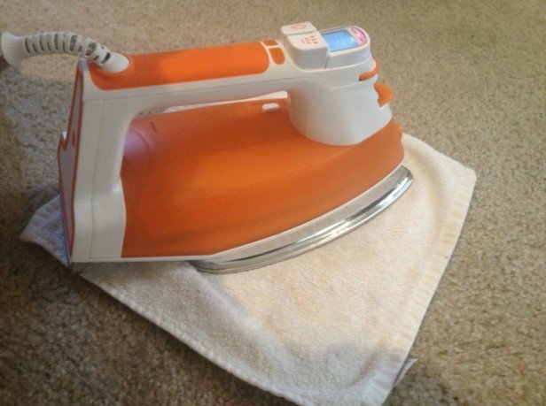 16 DIY Cleaning Hacks -remove stubborn stains from carpet with Iron