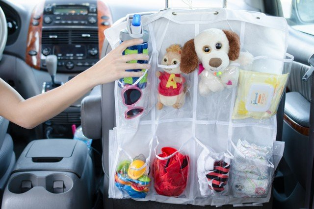 12 Brilliant Hacks To Keep Your Car Organized and Clean-Hanging backseat pockets with a shoe organizer.