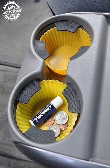 12 Brilliant Hacks To Keep Your Car Organized and Clean-Put silicone muffin liners in your cupholders.