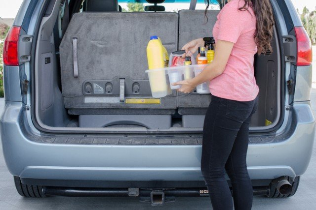 12 Brilliant Hacks To Keep Your Car Organized and Clean-Organize all the oil and fluids you need for a road trip in a shower caddy.