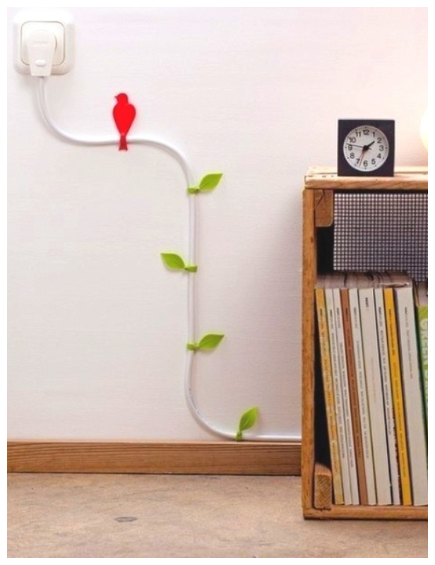 Turn your power chords into pretty vines - Genius Ways to Hide The Eyesores In Your Home
